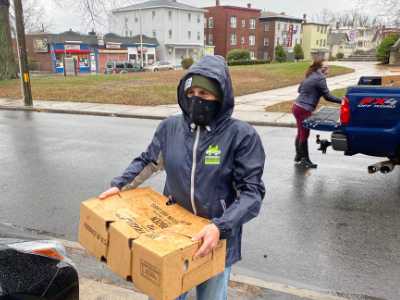 students delivering boxes of food