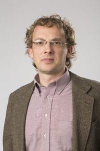 Isaac A. Kamola, Political Science