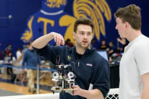 Trinity students Alex Prigge and Andrew Clark at the 2019 Robot Contest