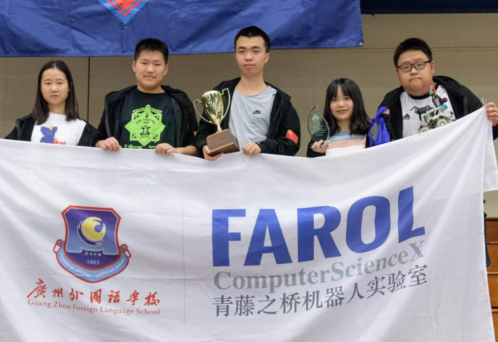 Guangzhou Foreign Language School robot team celebrates.