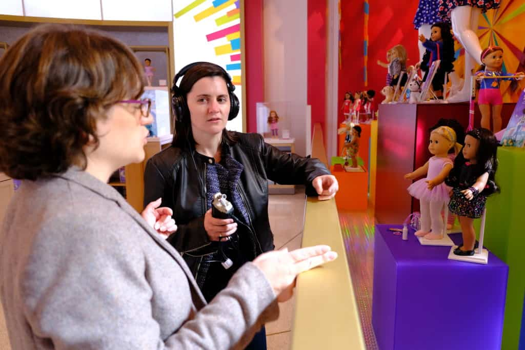 Allison Horrocks '09 and Mary Mahoney '09 take a moment during their visit to the American Girl Store to record thoughts for their podcast.