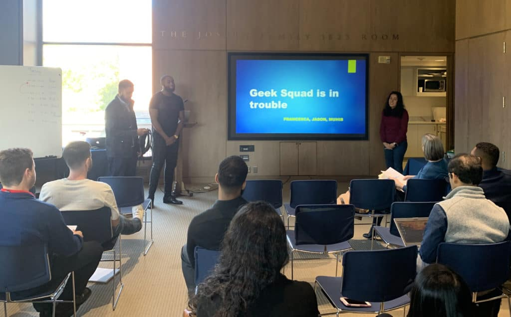 A group of new Infosys employees—including Trinity alumna Francesca L. Velarde '19 (right)—present to the group during a training module held in Trinity's Raether Library and Information Technology Center.