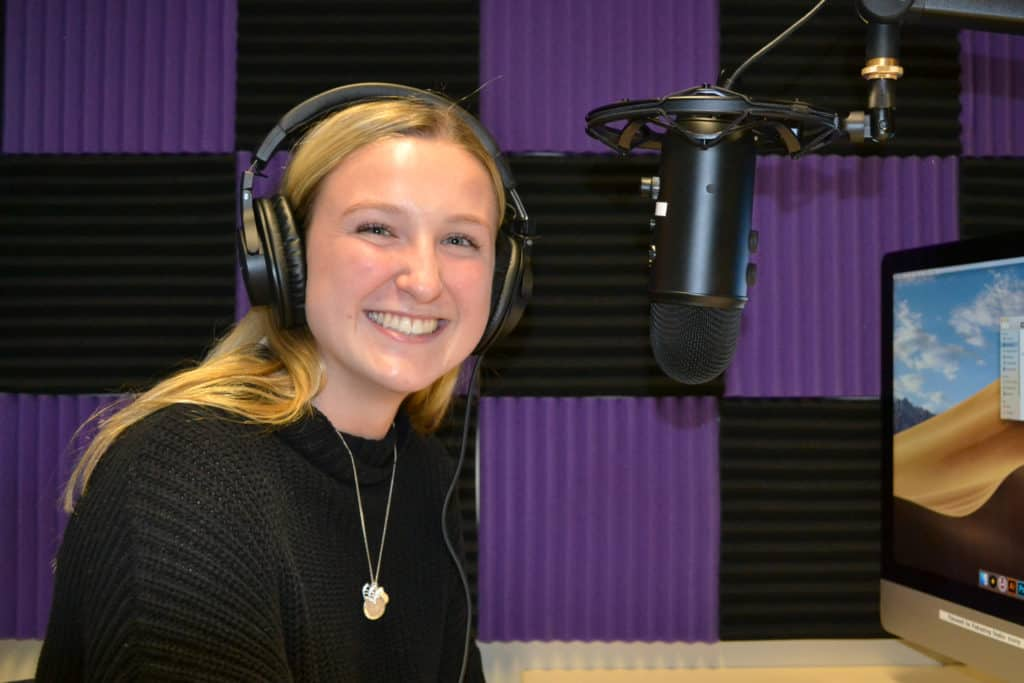 Emily Wickles '20 recording in a Story Lab podcast studio.