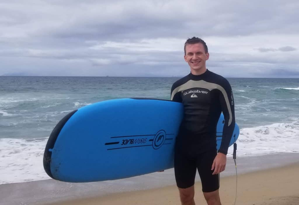 Skyler Szot '21 surfing at Huntington Beach