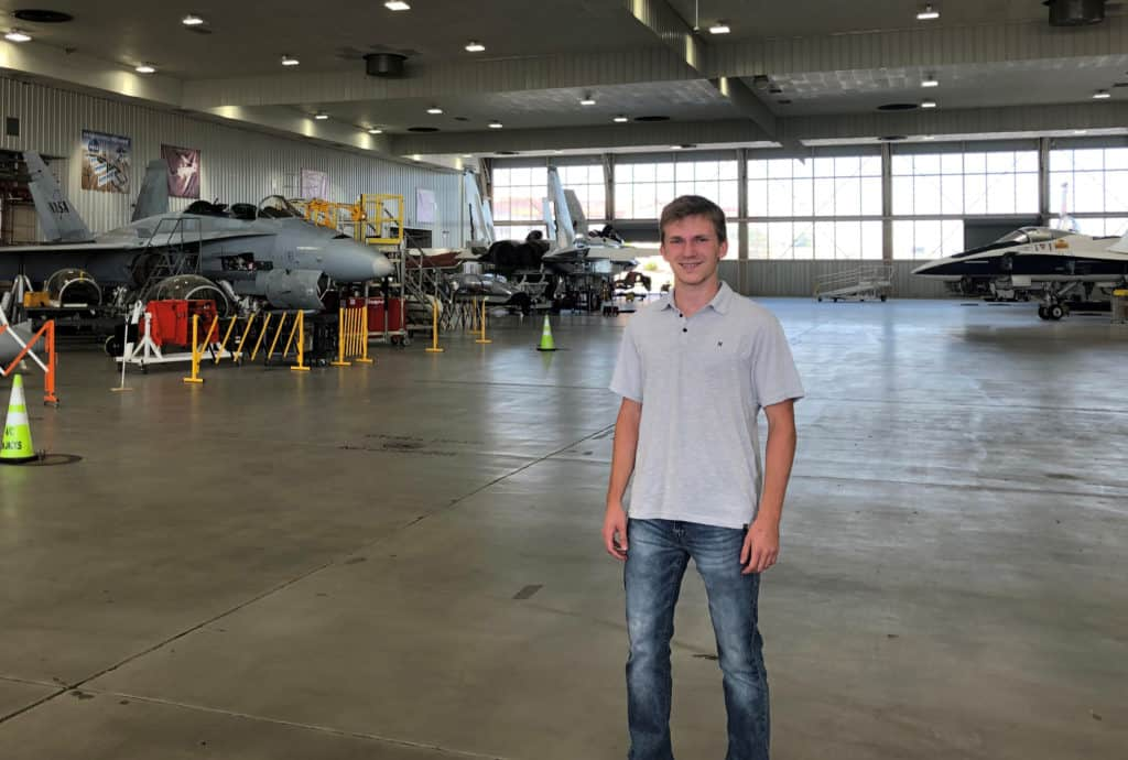 Skyler Szot '21 inside the NASA test plane hangar.