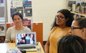 Josselyn Alejandra Zaldívar '20 presents on the Voices of Migration project at the Hartford Public Library Park Street branch in 2019.