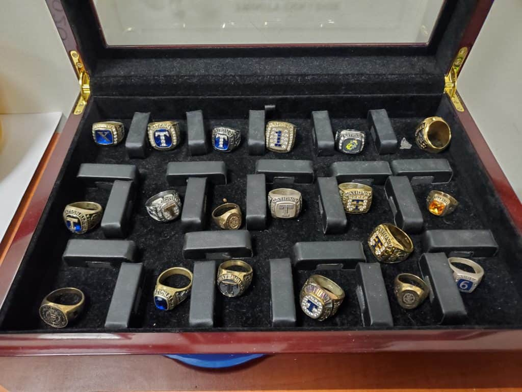 A collection of Trinity's squash championship rings.