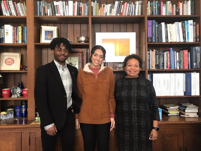 Trinity College President Joanne Berger-Sweeney (right) with Darius Borges '20 (left) and Ailani Cruceta '22, who are also quoted in the Hartford Courant article.