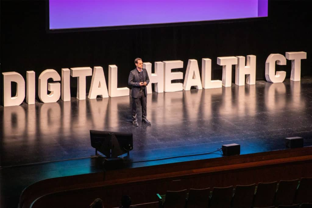 MDI Health co-founder and CEO Avishai Ben-Tovim pitches to the crowded Belding Theater at the Bushnell.