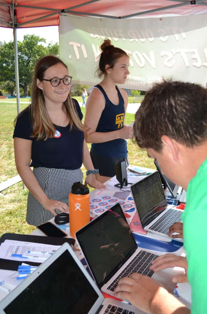 Maddy White '22 (left) leads a ConnPIRG Voter Registration Day event at Trinity in September 2019.