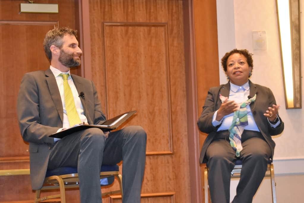 Trinity President Joanne Berger-Sweeney (left) with Joel N. Lohr, president of Hartford Seminary.