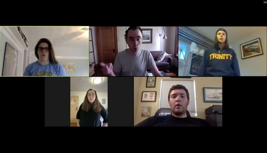Christopher Houlihan '09 (top, center) conducts a rehearsal of the Chapel Singers via Zoom.